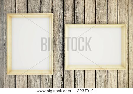 Two blank picture frames hanging on a wooden wall. Mock up 3D Render