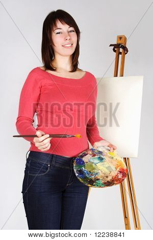 Young Girl In Red Shirt Standing Near Easel, Holding Brush And Palette, Smiling