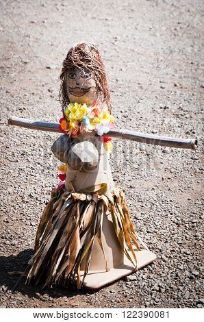 Hawaiian doll from traffic cone and nature materials