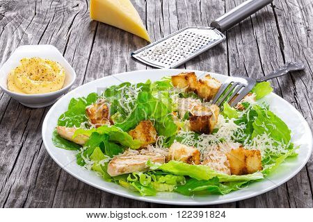 croutons grilled chicken breast grated parmesan cheese and romaine lettuce