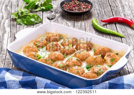 meatballs smothered in a creamy gravy sauce