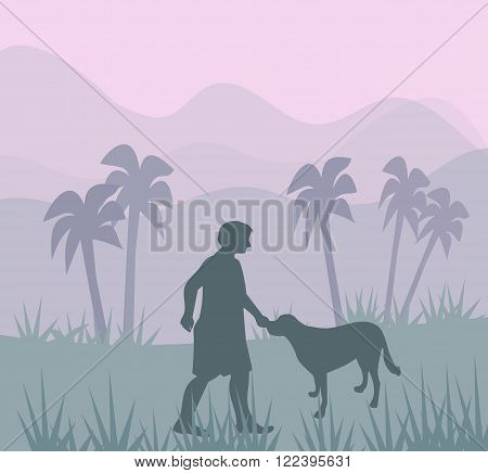 A man is patting a dog, in a landscape with palms, and mountains.