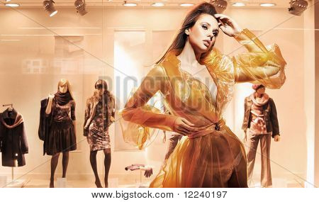 Sexy woman in front of a window shop