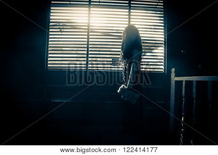Ghost girl in haunted house,Mysterious girl in black dress standing in abandon house