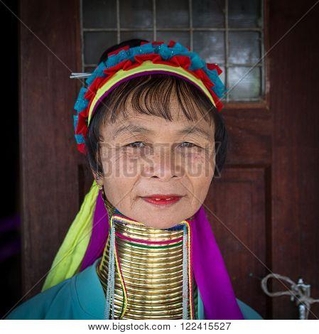 INLE LAKE MYANMAR - JANUARY 12 2016: Padaung Tribal woman poses for a photo in Inle lake Myanmar Burma The Padaung-Karen long-necked tribe women are minority of Myanmar.