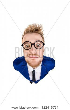 Funny smart guy in a suit and spectacles staring into the camera. Isolated over white.