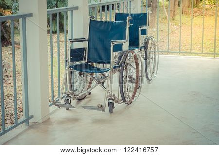 Wheelchair empty wait to use at hospital hallway , process in vintage style