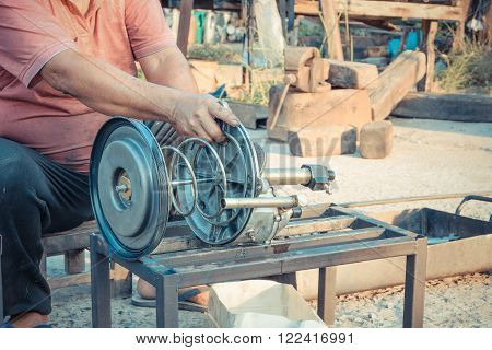Hands worker repair car truck part at garage