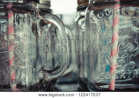 This a photo of Empty jar with straw