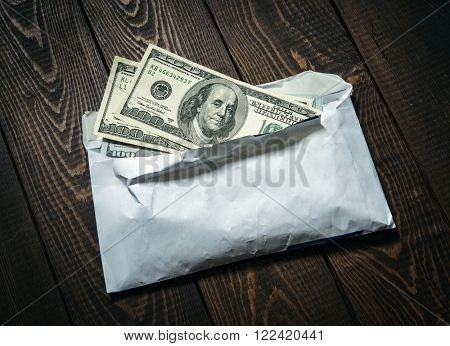American Dollars in the Envelope on the Table