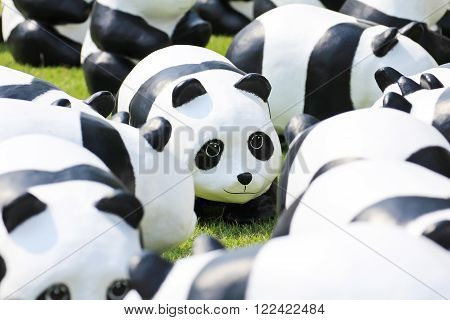 BANGKOKTHAILAND - MARCH 13 2016 : 1600 Pandas+ TH Paper mache Pandas to represent 1600 Pandas and to raise awareness in conservation and sustainable development for endangered animals in Thailand.