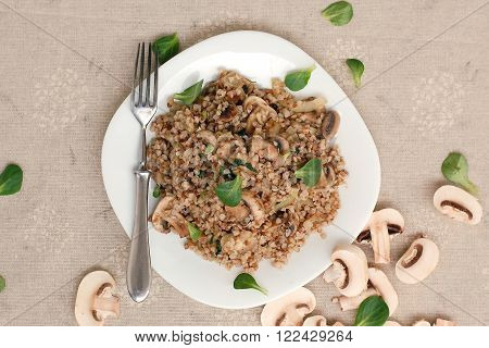 Buckwheat with mushroom and lettuce overhaead view poster
