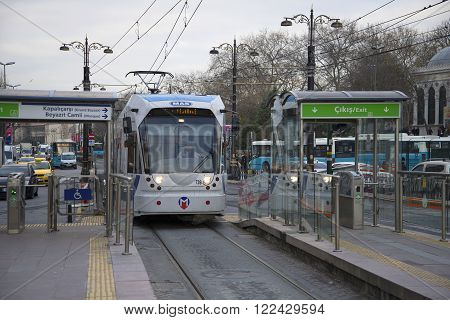 ISTANBUL, TURKEY - JANUARY 02, 2015: The T1 tram arrives at the stop Beyazit Kapalicarsi. Urban transport in the city of Istanbul