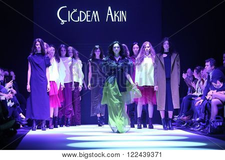 ISTANBUL, TURKEY - MARCH 16, 2016: A model showcases one of the latest creations of Cigdem Akin in Mercedes-Benz Fashion Week Istanbul
