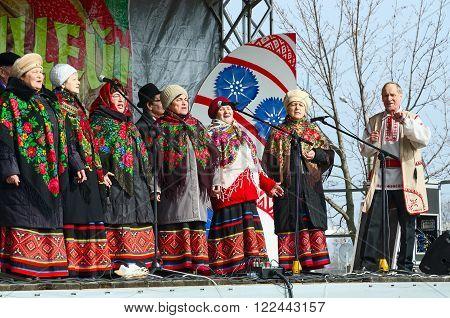 GOMEL BELARUS - MARCH 12 2016: Speech amateur choral collective during Shrovetide celebrations Gomel Belarus