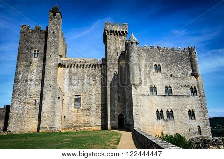 Medieval architecture of impressive Chateau de Beynac castle built on the cliffs high above Dordogne river in Beynac-et-Cazenac Perigord France.