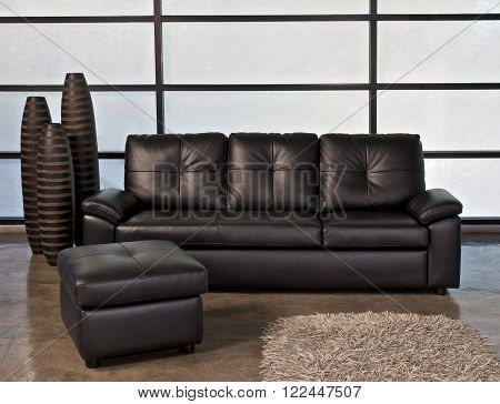 Black leather sofa with stool for home or office ** Note: Soft Focus at 100%, best at smaller sizes