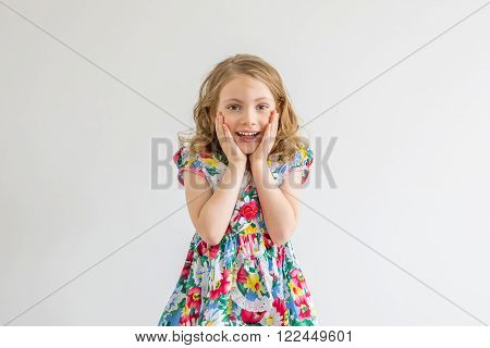 surprised girl with hands up isolated on white