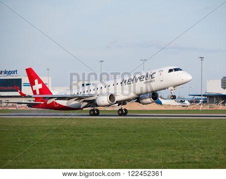 PRAGUE, CZECH REPUBLIC - CIRCA APRIL 2015: Helvetic Airways Embraer 190 landing at Vaclav Havel Airport Prague PRG in april 2015