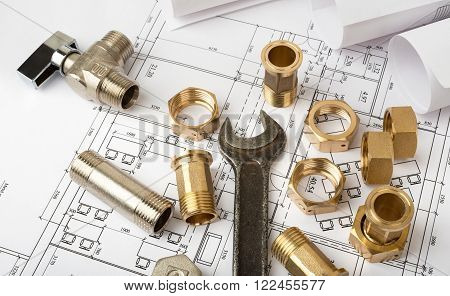 Architecture plan with plunger pins and turn-screw, closeup. Building concept