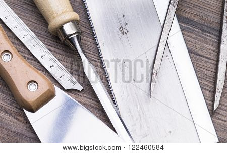 Image shows a set of tools on wooden table top view