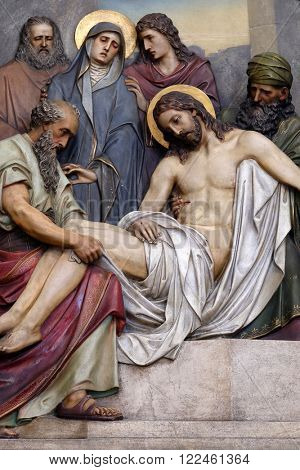 ZAGREB, CROATIA - SEPTEMBER 14: 14th Stations of the Cross, Jesus is laid in the tomb and covered in incense, Basilica of the Sacred Heart of Jesus in Zagreb, Croatia on September 14, 2015