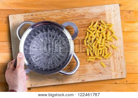 Man Preparing To Cook Dried Italian Rotini Pasta