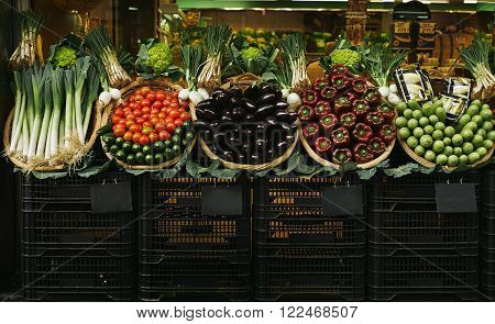 Fresh Vegetables In Baskets Presented Outside On Market For Sale