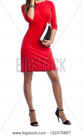 Close up of a beautiful slim woman's body wearing a red dress. and high heels. White isolated background.