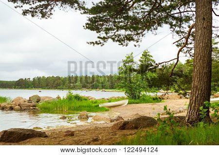 White Boat On Sandy Shore. Hamina Camping, Finland, Suomi