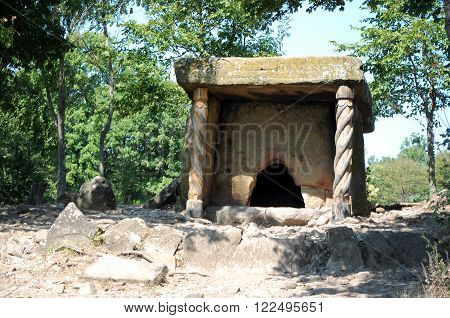 ancient stone dolmen in the forest in summer