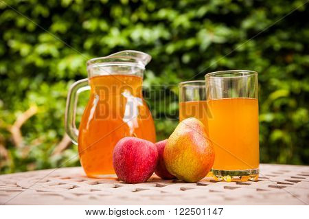 Jug of iced tea or kombucha on a garden table