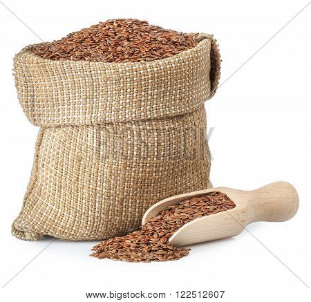 Flax seed in burlap bag with wooden scoop isolated on white background closeup