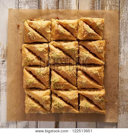 two dozen baklava in flat lay composition