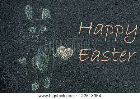 Eastern Bunny drawn by a kid on a street with a Happy Easter wishes.
