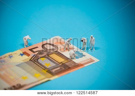 Specialists inspecting 50 euro banknote. Fraud concept. Macro photo