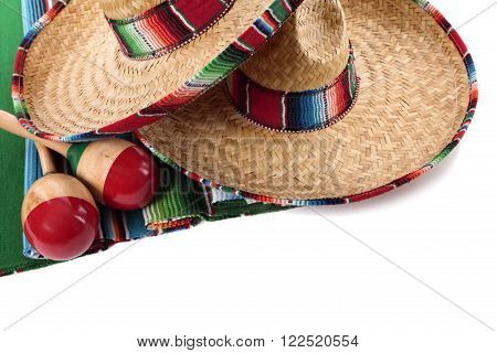 Traditional Mexican serape blanket or rug with sombreros and maracas isolated against a white background. Space for copy.