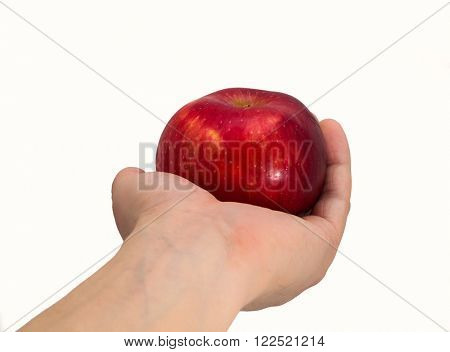 Apple in a hand on a white background
