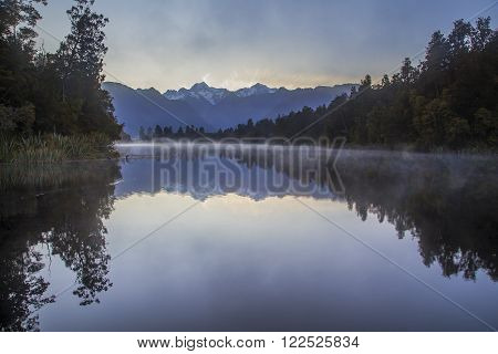 Reflection of the Southern Alps in Lake Matheson South Island New Zealand