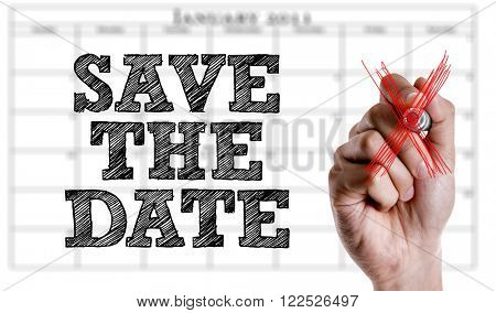 Hand writing the text: Save The Date