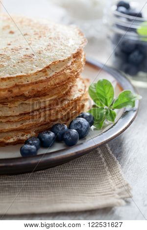 close up view of nice yummy crepes with berry on table poster