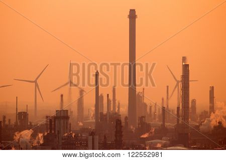 Chimneys from industrial plants and factory's at sunset