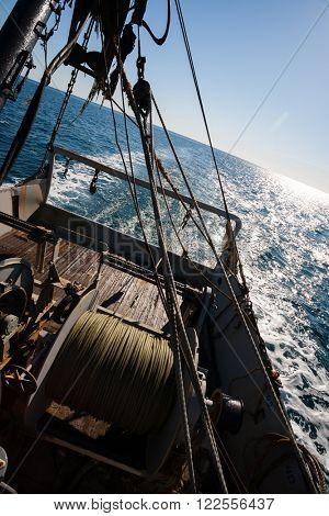 Fishing boat fishing by trawl in coastal waters. Sea of Japan.