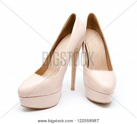 Biege high heel woman shoes isolated on a white background