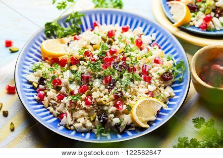 Cauliflower couscous with dried cranberry, pomegranate, pistachio and pine nut