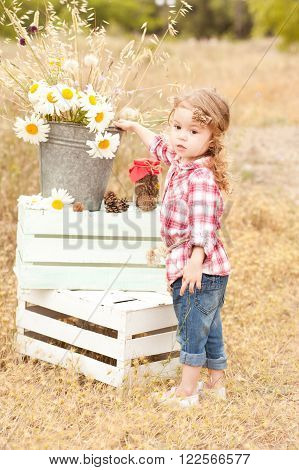 Cute baby girl 2-3 year old standing outdoors. Playful. Childhood. Summer time.