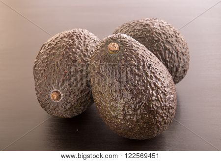 group of Avocados on a black background