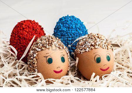 little men and colored Easter eggs handmade