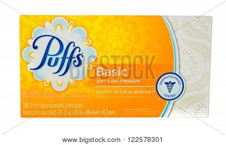 Winneconne, WI - 4 February 2015: Package of Pufss Basic facial tissue. Puffs was first created in 1950's and didn't become nationaly available till the 1980's.