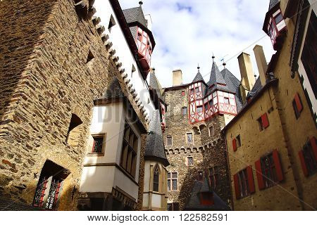 KOBLENZ, GERMANY - SEPTEMBER 29, 2012: Eltz Castle. Medieval Eltz castle nestled in the hills above the Moselle River. It is still owned by the Eltz family that lived there in the 12th century.